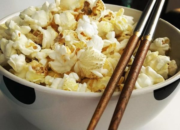 Why you should eat popcorn with chopsticks – and other psychological tricks to make life more enjoyable